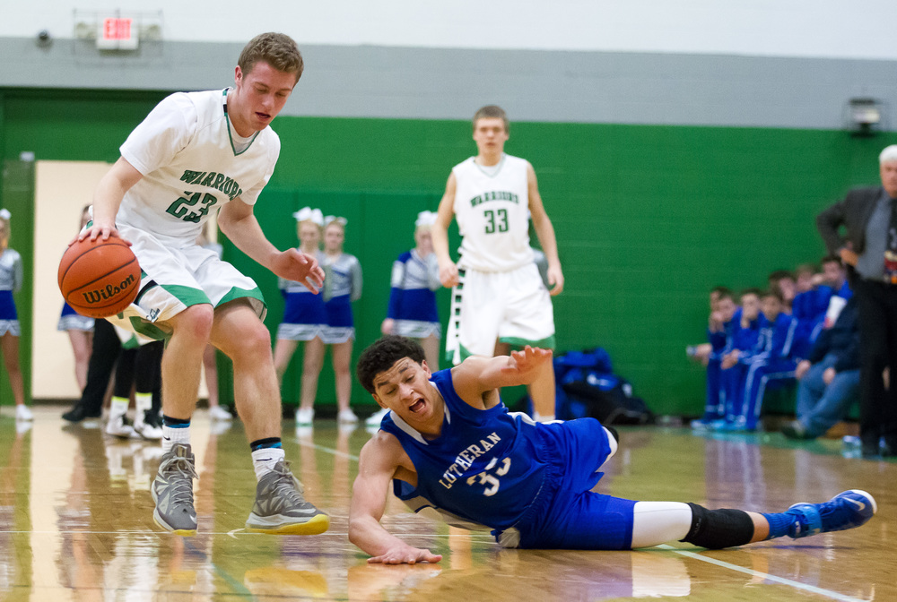 Athens' Ryan Freer (23) wins a loose ball against Lutheran's Pierson Wofford (35) in the first half at Athens High School, Friday, Feb. 20, 2015, in Athens, Ill. Justin L. Fowler/The State Journal-Register