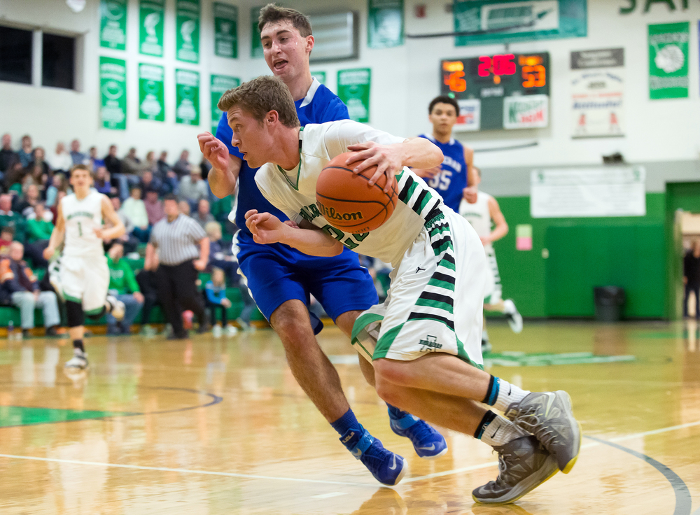 Athens' Ryan Freer (23) dribbles around the edge of Lutheran's Adam Forestier (15) as he drives to the basket in the second half at Athens High School, Friday, Feb. 20, 2015, in Athens, Ill. Justin L. Fowler/The State Journal-Register