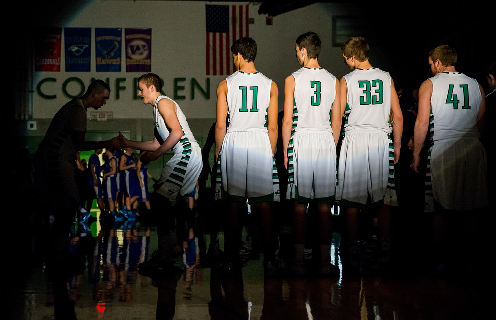 Athens players are introduced under the spotlight as they prepare to take on Lutheran at Athens High School, Friday, Feb. 20, 2015, in Athens, Ill. Justin L. Fowler/The State Journal-Register