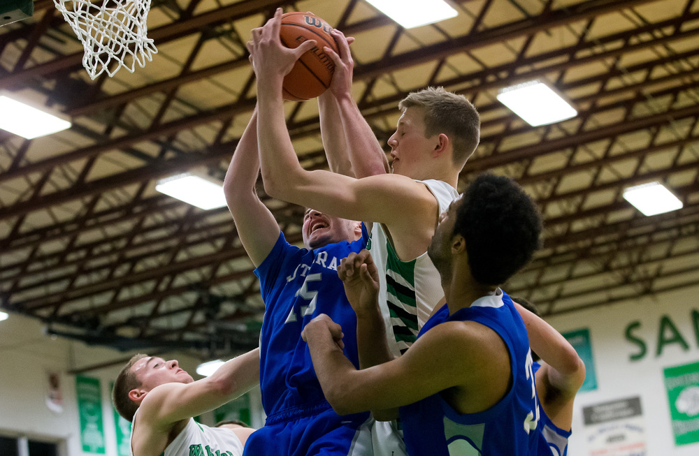 Athens' Matt Wendling (5) and Lutheran's Adam Forestier (15) battle for a rebound underneath the basket in the first half at Athens High School, Friday, Feb. 20, 2015, in Athens, Ill. Justin L. Fowler/The State Journal-Register