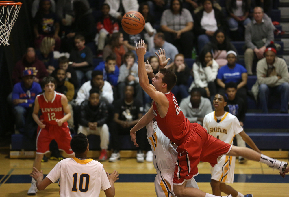 Glenwood's Cole Harper goes airborne as he shoots for two points against the Titans Friday night. Southeast defeated Glenwood 47-44 in boys basketball action at Southeast's Scheffler Gymnasium in Springfield on Friday evening, Feb. 20, 2015. David Spencer/The State Journal-Register