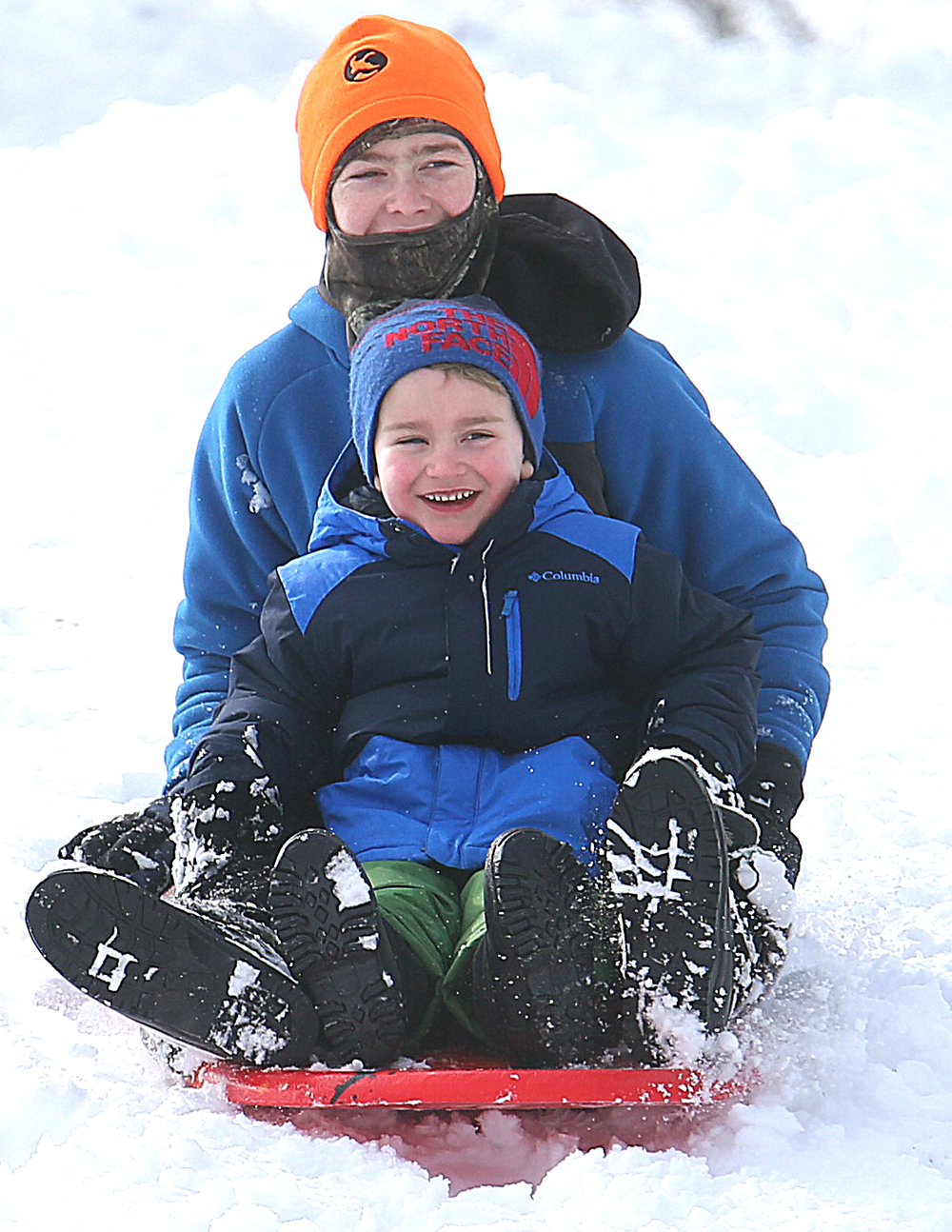 Charlie Graham, 3 at front and Barrett Kurmann, 14 sled together down a hill inside Washington Park Saturday morning. On Saturday, the Springfield area began digging out of its most significant winter storm of the season after nearly a foot of snow fell. The National Weather Service's official snow total for the capital city was 11.8 inches, as of 6 a.m. A total of 8.9 inches of snow fell at Abraham Lincoln Capital Airport Friday night, breaking the previous record for Feb. 20 of 3.6 inches set in 1989, the weather service reported. David Spencer/The State Journal-Register
