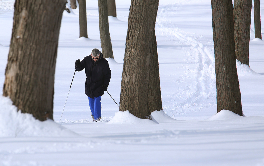 Springfield resident Craig Kniffin said it was the first time in 25 years that he did some cross country skiing early Saturday morning in Washington Park using a new pair of skiis. On Saturday, the Springfield area began digging out of its most significant winter storm of the season after nearly a foot of snow fell. The National Weather Service's official snow total for the capital city was 11.8 inches, as of 6 a.m. A total of 8.9 inches of snow fell at Abraham Lincoln Capital Airport Friday night, breaking the previous record for Feb. 20 of 3.6 inches set in 1989, the weather service reported. David Spencer/The State Journal-Register
