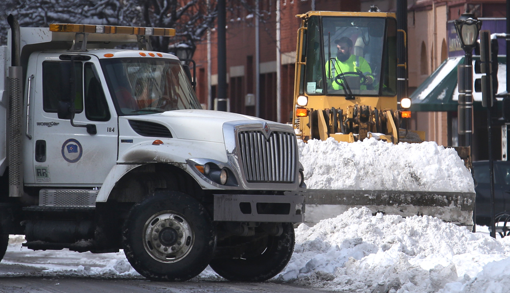 City public work crews were using an endloader and dumptrucks to clear snow along Monroe St. near Muncipal Center west in downtown Springfield Saturday morning. On Saturday, the Springfield area began digging out of its most significant winter storm of the season after nearly a foot of snow fell. The National Weather Service's official snow total for the capital city was 11.8 inches, as of 6 a.m. A total of 8.9 inches of snow fell at Abraham Lincoln Capital Airport Friday night, breaking the previous record for Feb. 20 of 3.6 inches set in 1989, the weather service reported. David Spencer/The State Journal-Register