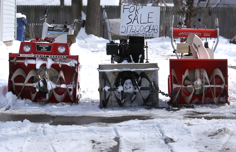 A collection of old snowblowers for sale were lined up along Walnut St. in Springfield. On Saturday, the Springfield area began digging out of its most significant winter storm of the season after nearly a foot of snow fell. The National Weather Service's official snow total for the capital city was 11.8 inches, as of 6 a.m. A total of 8.9 inches of snow fell at Abraham Lincoln Capital Airport Friday night, breaking the previous record for Feb. 20 of 3.6 inches set in 1989, the weather service reported. David Spencer/The State Journal-Register