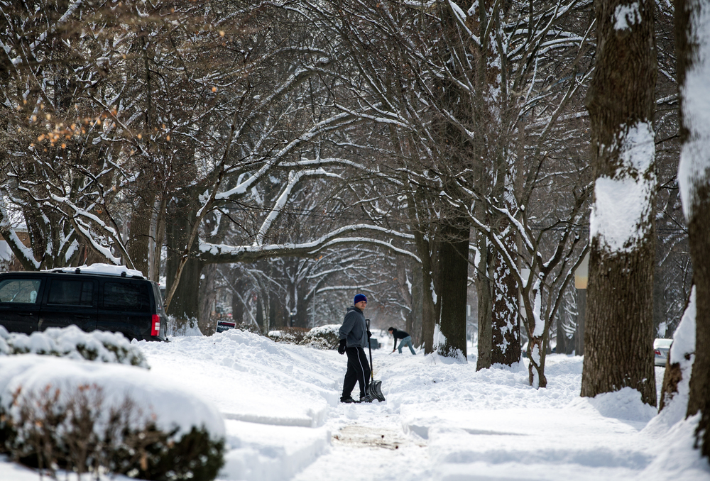 Residents being digging out along South Glenwood Avenue after nearly a foot of snow fell overnight, Saturday, Feb. 21, 2015, in Springfield, Ill. Justin L. Fowler/The State Journal-Register
