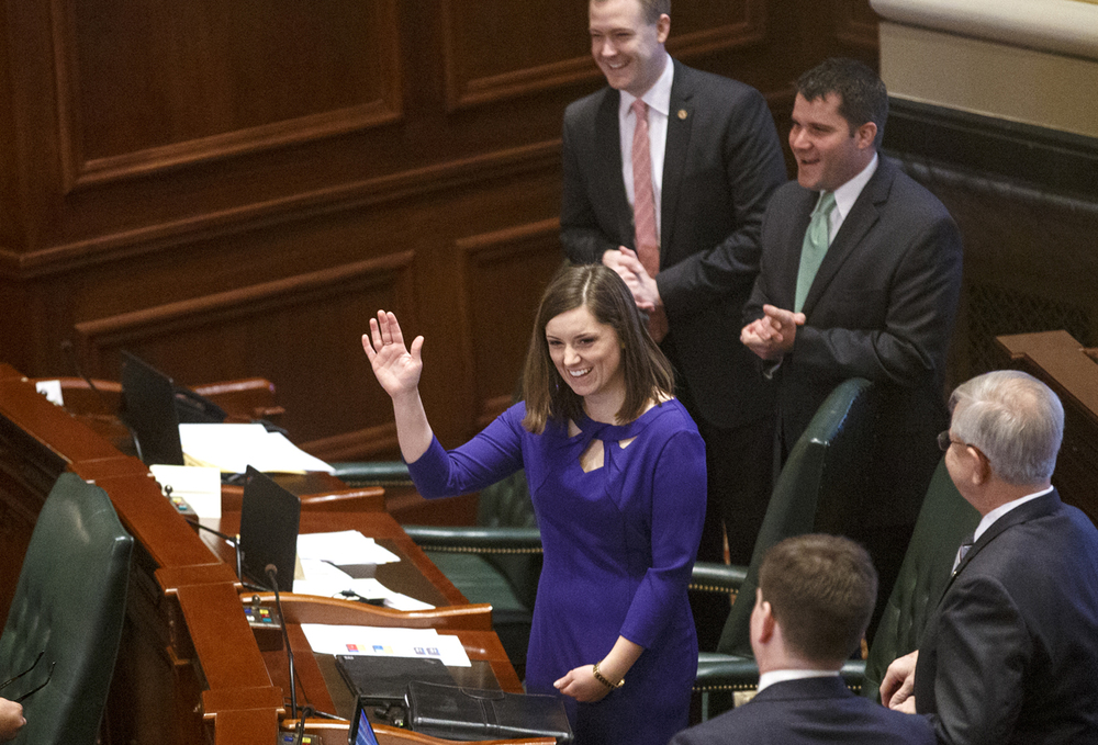 Avery Bourne waves to members of the General Assembly before the budget address in the Illinois House of Representatives Wednesday, Feb. 18, 2015. Bourne was selected to replace Wayne Rosenthal as state representative in the 95th District after Gov. Bruce Rauner appointed Rosenthal to head the Illinois Department of Natural Resources. Ted Schurter/The State Journal-Register.