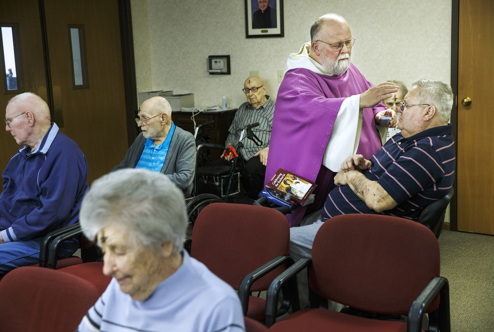 Father Charles Dahlby conducts the imposition of ashes to Albert Goodson's forehead during Ash Wednesday, the first day of the Lent in the Christian church, during a service at The Villas Senior Care Community in Sherman Wednesday, Feb. 18, 2015. Ted Schurter/The State Journal-Register