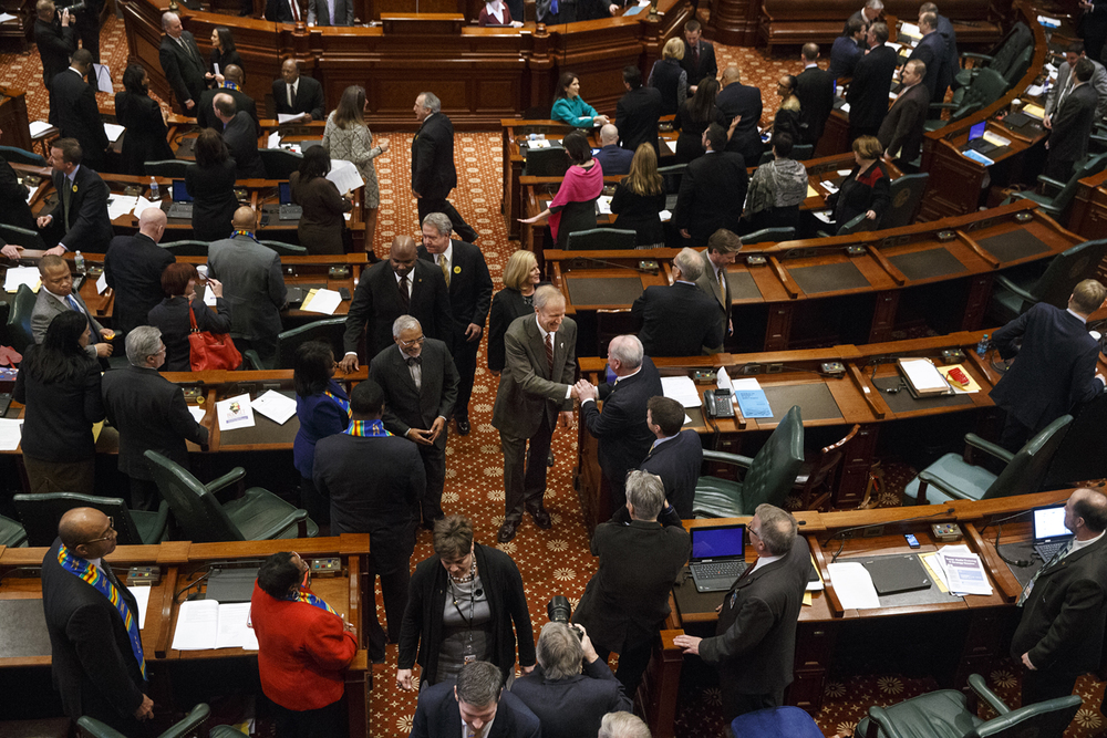 "Illinois Gov. Bruce Rauner greets legislators after delivering his budget address in the Illinois House of Representatives Wednesday, Feb. 18, 2015. He said lawmakers must be willing to make unpopular decisions after years of ""financial recklessness."" Ted Schurter/The State Journal-Register"