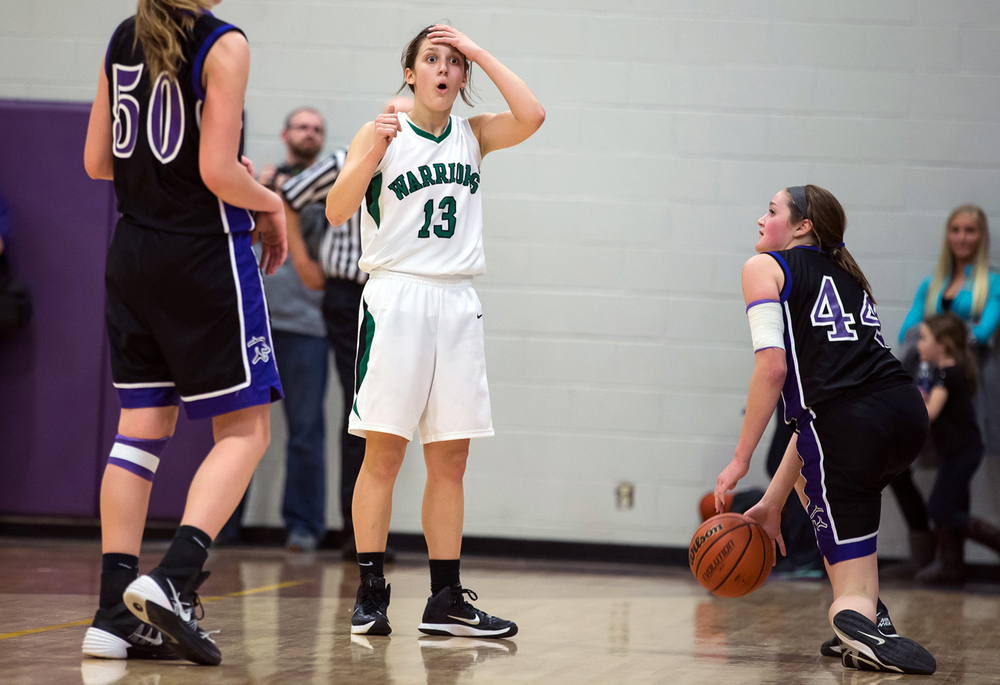 Athens' Madi Epperson (13) reacts after being called for a foul while guarding Litchfield's Abby Frerichs (44) in the second half during the Class 2A Williamsville sectional title game, Thursday, Feb. 19, 2015, in Williamsville, Ill. Justin L. Fowler/The State Journal-Register