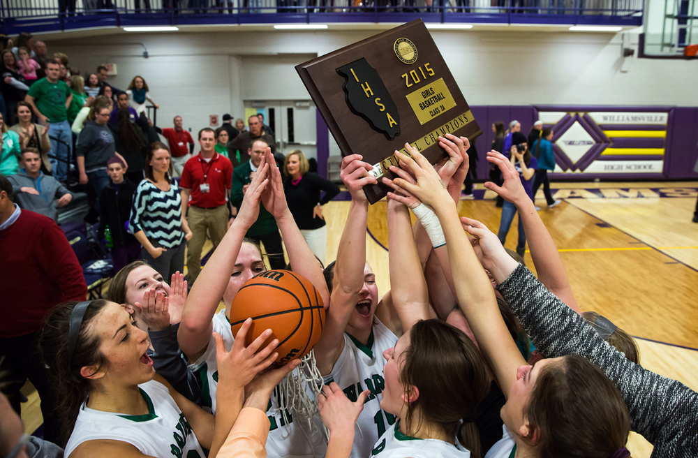 Athens' JJ Penrod (22) left grabs the game ball as the Warriors celebrate with the schools first sectional title after defeating Litchfield 42-38 in the Class 2A Williamsville sectional title game, Thursday, Feb. 19, 2015, in Williamsville, Ill. Justin L. Fowler/The State Journal-Register