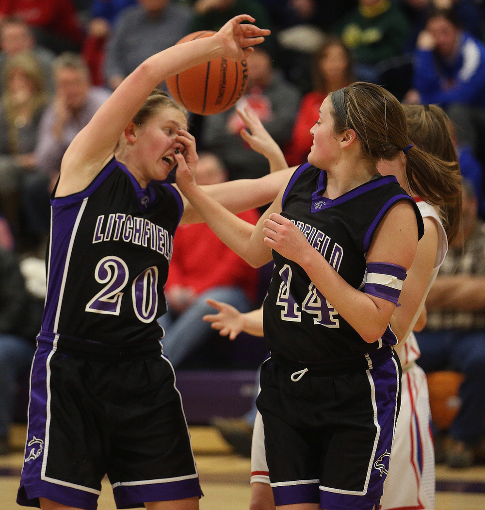 Litchfield's Anna Thomack, who ended up scoring the winning basket at the end of the game, gets an inadvertent hand in her face by teammate Abby Frerichs earlier in the game. Litchfield defeated Pleasant Plains 22-21 in 2A girls sectional basketball action at Williamsville High School gym on Tuesday evening, Feb. 17, 2015. David Spencer/The State Journal-Register