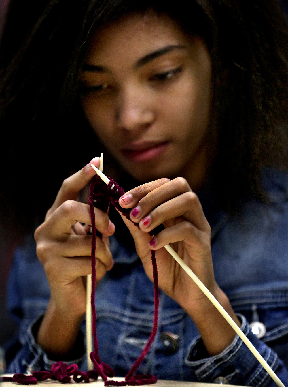 Seventh grade student Rinoa Chance, 12, works on her knitting skills at the school on Tuesday, Feb. 17, 2015. Springfield's Lincoln Magnet School Knitting and Crocheting club meets every Tuesday after school.  David Spencer/The State Journal-Register