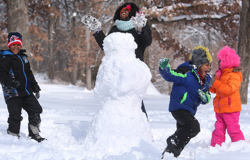 "Springfield resident Wonzey Carlson had fun making a snowman with her children at Washington Park Saturday morning, which included a snowball fight. From left to right: Michael Carlson Jr. , 6, Obadiah Carlson, 4, Tryphena Carlson, 3. The family decided to name their snowman ""Olaf III"". On Saturday, the Springfield area began digging out of its most significant winter storm of the season after nearly a foot of snow fell. The National Weather Service's official snow total for the capital city was 11.8 inches, as of 6 a.m. A total of 8.9 inches of snow fell at Abraham Lincoln Capital Airport Friday night, breaking the previous record for Feb. 20 of 3.6 inches set in 1989, the weather service reported. David Spencer/The State Journal-Register"