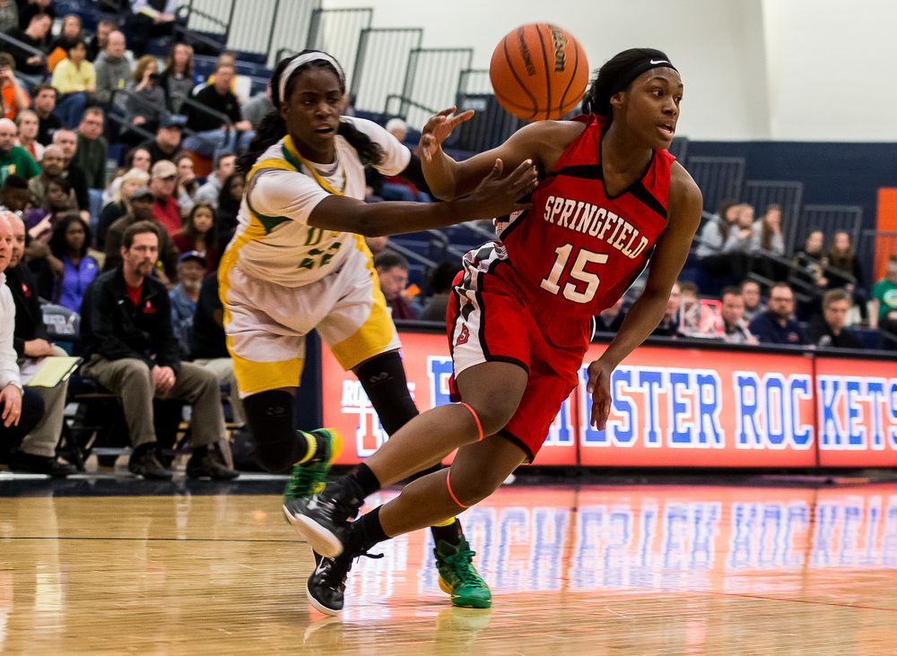 Normal U-High's Chante Stonewall (22) knocks the ball away from Springfield's Kierra Weir (15) as she drives to the basket in the second half during the Class 3A Rochester Sectional at the Rochester Athletic Complex , Monday, Feb. 23, 2015, in Rochester, Ill. Justin L. Fowler/The State Journal-Register