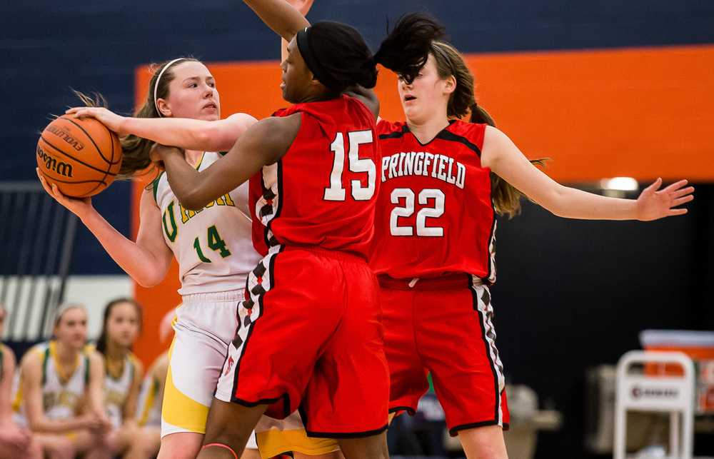Normal U-High's Amber Nanni (14) is smothered by Springfield's Kierra Weir (15) and Sarah Cross (22) in the second half during the Class 3A Rochester Sectional at the Rochester Athletic Complex , Monday, Feb. 23, 2015, in Rochester, Ill. Justin L. Fowler/The State Journal-Register