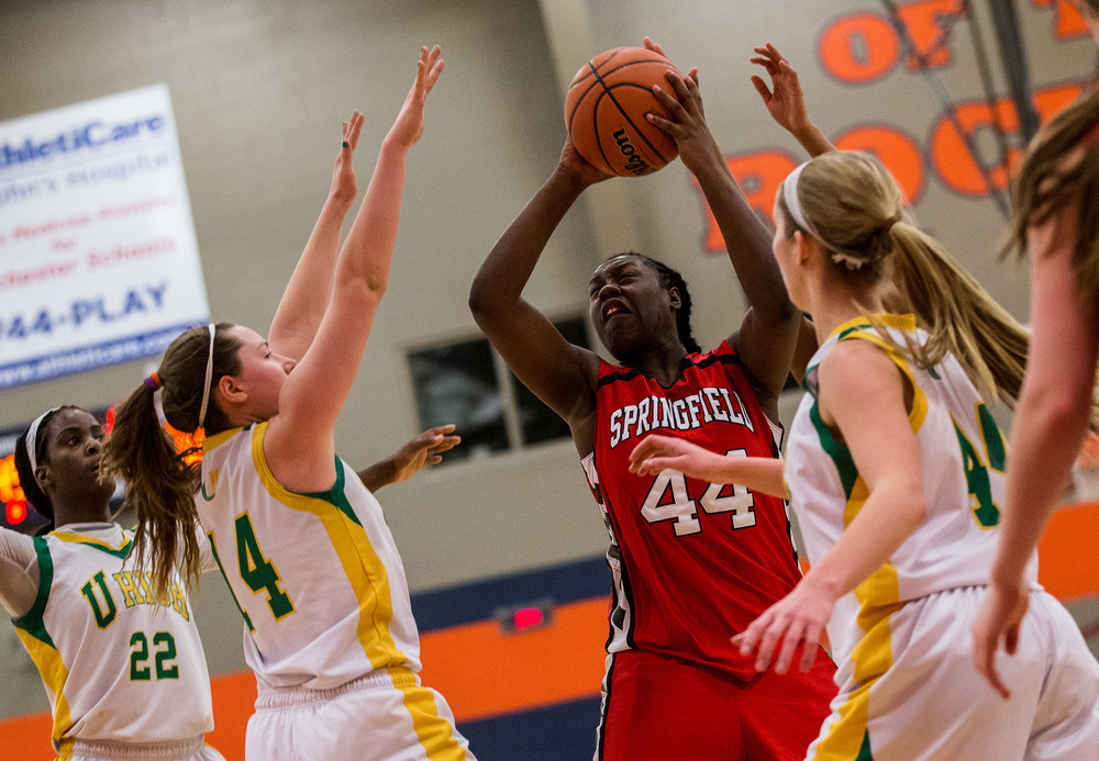 Springfield's Montshianna Pulliam (44) battles against Normal U-High's Amber Nanni (14) as she goes up for a basket in the second half during the Class 3A Rochester Sectional at the Rochester Athletic Complex , Monday, Feb. 23, 2015, in Rochester, Ill. Justin L. Fowler/The State Journal-Register