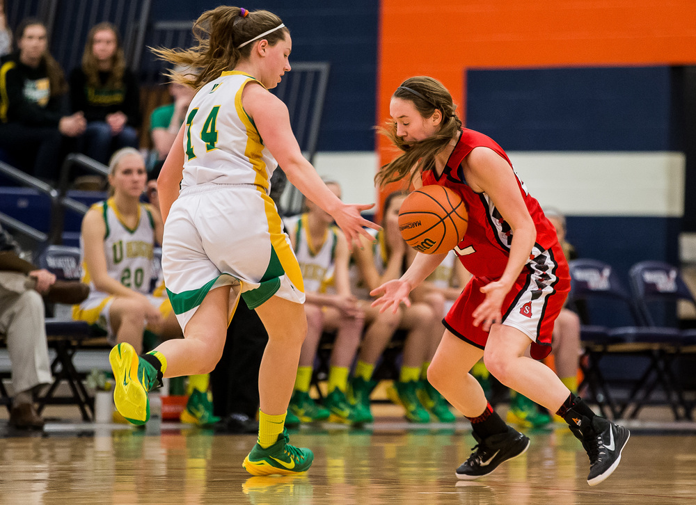 Springfield's Sarah Cross (22) steals the ball from Normal U-High's Amber Nanni (14) in the second half during the Class 3A Rochester Sectional at the Rochester Athletic Complex , Monday, Feb. 23, 2015, in Rochester, Ill. Justin L. Fowler/The State Journal-Register