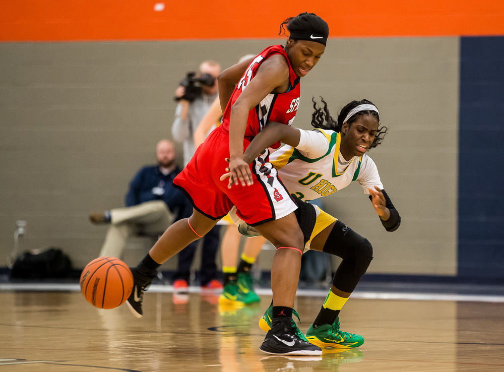 Springfield's Kierra Weir (15) fouls Normal U-High's Chante Stonewall (22) while trying to force a turnover in the second half during the Class 3A Rochester Sectional at the Rochester Athletic Complex , Monday, Feb. 23, 2015, in Rochester, Ill. Justin L. Fowler/The State Journal-Register