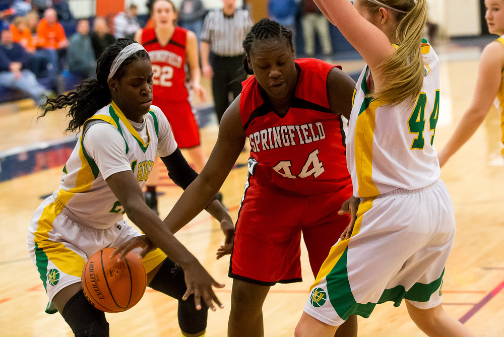 Springfield's Montshianna Pulliam (44) has the ball stolen away from here by Normal U-High's Chante Stonewall (22)  in the first half during the Class 3A Rochester Sectional at the Rochester Athletic Complex , Monday, Feb. 23, 2015, in Rochester, Ill. Justin L. Fowler/The State Journal-Register