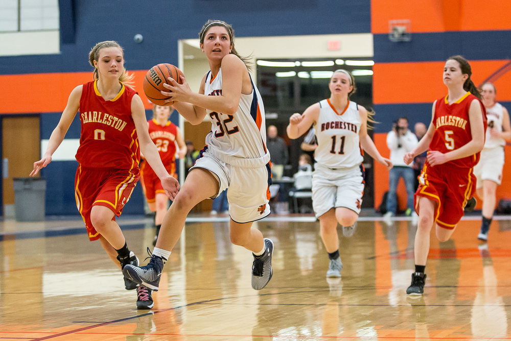 Rochester's Laryn Sapetti (32) drives to the basket on a fast break as Charleston's Dakota Crowder (0) comes up from behind to try and knock the ball away in the second half during the Class 3A Rochester Sectional at the Rochester Athletic Complex , Monday, Feb. 23, 2015, in Rochester, Ill. Justin L. Fowler/The State Journal-Register