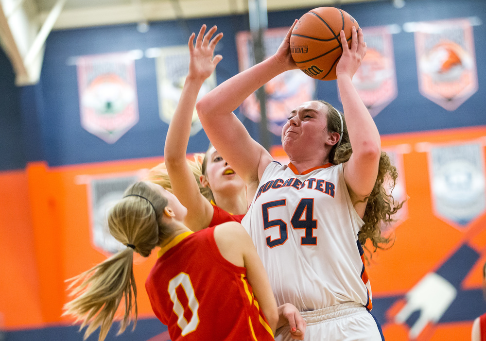 Rochester's Angela Perry (54) powers up to the basket against Charleston's Dakota Crowder (0) in the second half during the Class 3A Rochester Sectional at the Rochester Athletic Complex , Monday, Feb. 23, 2015, in Rochester, Ill. Justin L. Fowler/The State Journal-Register