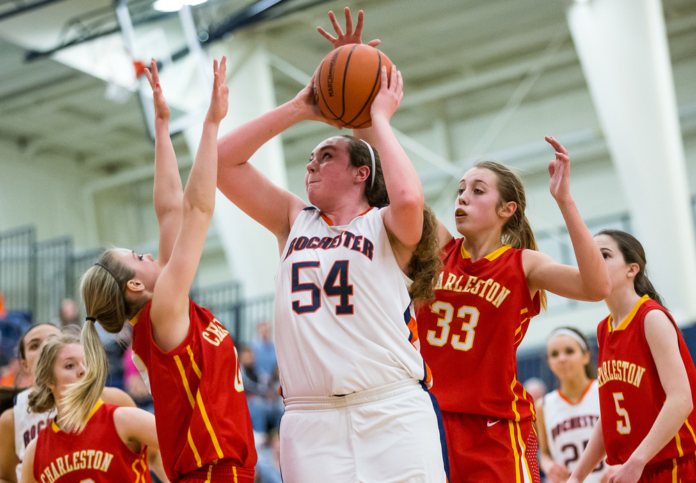 Rochester's Angela Perry (54) puts up a shot while under pressure from Charleston's Dakota Crowder (0) in the second half during the Class 3A Rochester Sectional at the Rochester Athletic Complex , Monday, Feb. 23, 2015, in Rochester, Ill. Justin L. Fowler/The State Journal-Register