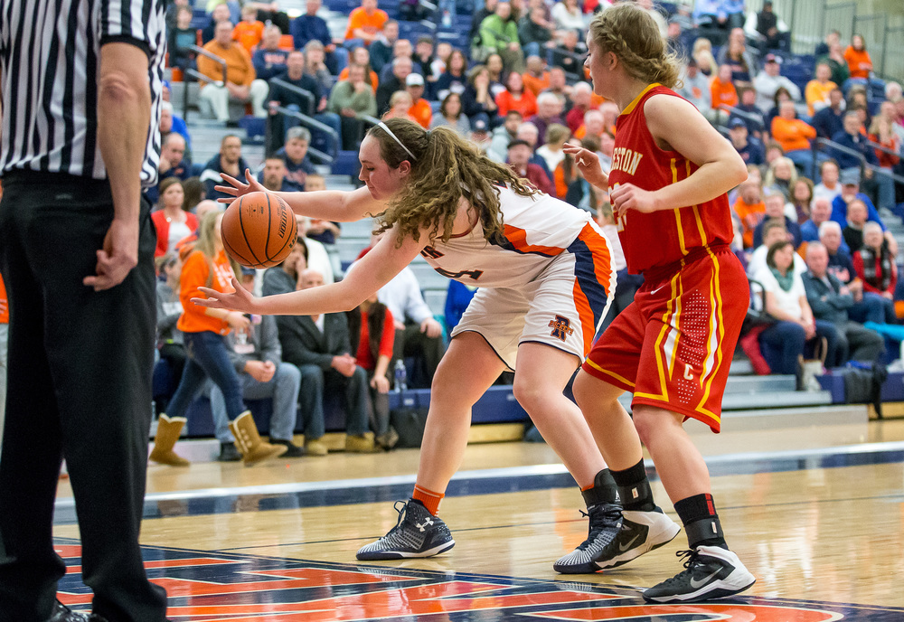 Rochester's Angela Perry (54) saves a ball from going out of bounds against Charleston in the second half during the Class 3A Rochester Sectional at the Rochester Athletic Complex , Monday, Feb. 23, 2015, in Rochester, Ill. Justin L. Fowler/The State Journal-Register