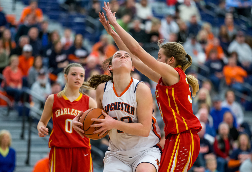 Rochester's Sami Kearney (43) drives up under the basket against Charleston's Morgan Sherwood (33)  in the second half during the Class 3A Rochester Sectional at the Rochester Athletic Complex , Monday, Feb. 23, 2015, in Rochester, Ill. Justin L. Fowler/The State Journal-Register