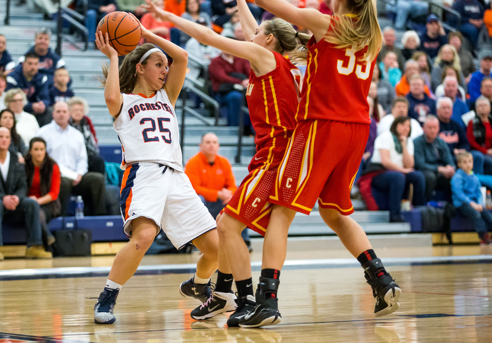 Rochester's Sydney Lett (25) looks for an opening to pass while being double teamed by Charleston in the second half during the Class 3A Rochester Sectional at the Rochester Athletic Complex , Monday, Feb. 23, 2015, in Rochester, Ill. Justin L. Fowler/The State Journal-Register