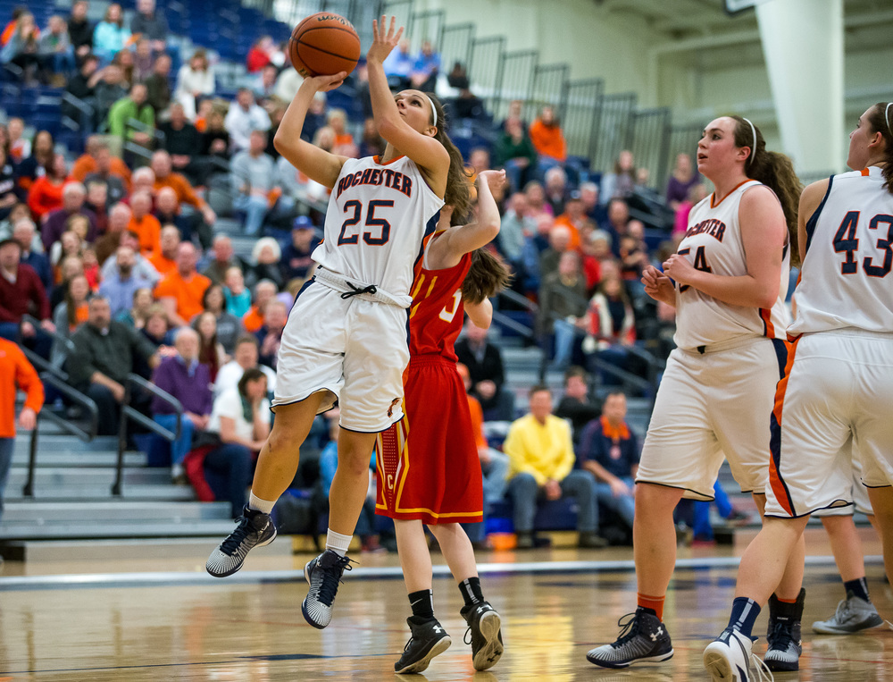 Rochester's Sydney Lett (25) puts up a shot against Charleston's Aislinn Parish (5) in the second half during the Class 3A Rochester Sectional at the Rochester Athletic Complex , Monday, Feb. 23, 2015, in Rochester, Ill. Justin L. Fowler/The State Journal-Register
