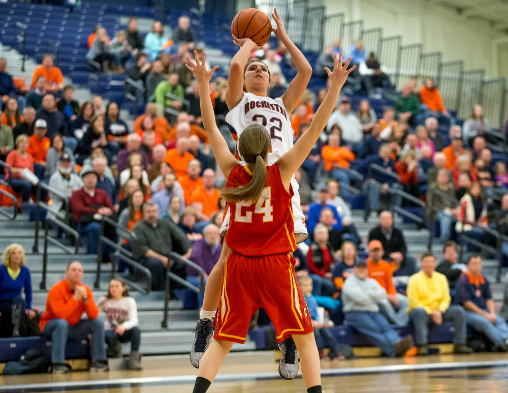 Rochester's Laryn Sapetti (32) shoots a jumper in front of Charleston's Paige Swango (24) in the second half during the Class 3A Rochester Sectional at the Rochester Athletic Complex , Monday, Feb. 23, 2015, in Rochester, Ill. Justin L. Fowler/The State Journal-Register