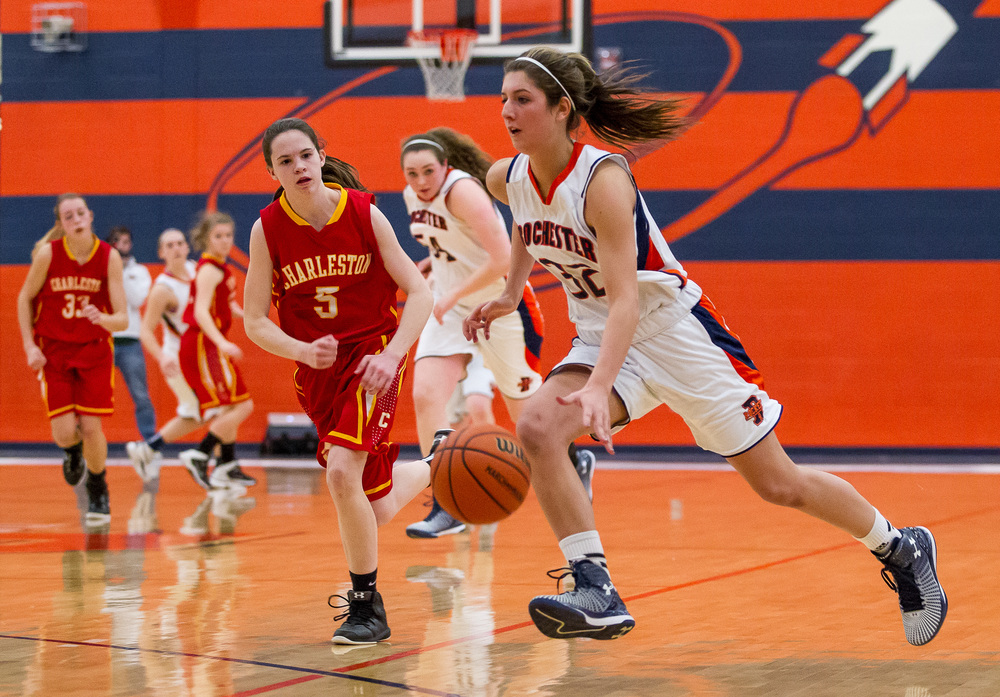 Rochester's Laryn Sapetti (32) drives the ball towards the basket after making a steal against Charleston's Aislinn Parish (5) in the second half during the Class 3A Rochester Sectional at the Rochester Athletic Complex , Monday, Feb. 23, 2015, in Rochester, Ill. Justin L. Fowler/The State Journal-Register
