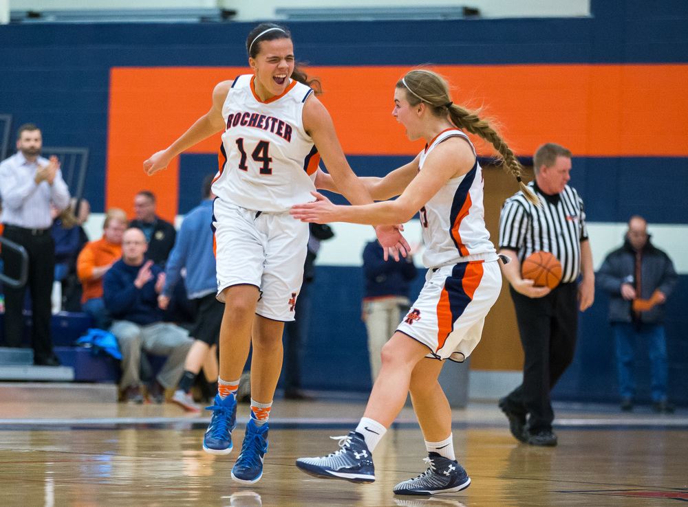 Rochester's Lyric Boone (14) is fired up with teammate Meagan McNicholas (33) going into halftime against Charleston in the first half during the Class 3A Rochester Sectional at the Rochester Athletic Complex , Monday, Feb. 23, 2015, in Rochester, Ill. Justin L. Fowler/The State Journal-Register