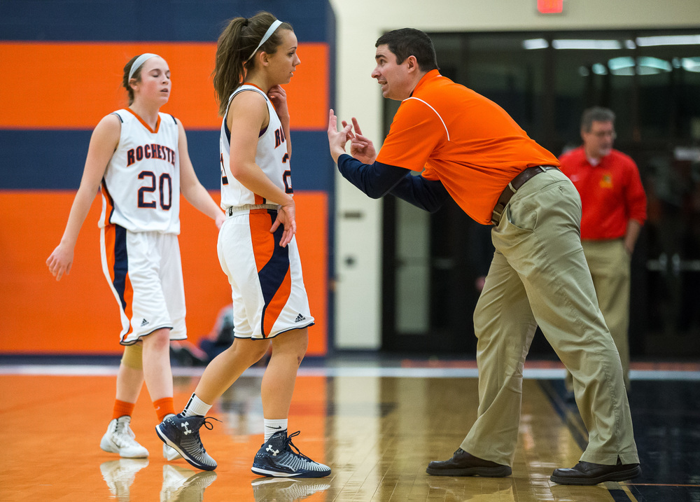 Rochester girls basketball head coach J.R. Boudouris comes out to talk to Rochester's Sydney Lett (25) along the sidelines as the Rockets take on Charleston in the first half during the Class 3A Rochester Sectional at the Rochester Athletic Complex , Monday, Feb. 23, 2015, in Rochester, Ill. Justin L. Fowler/The State Journal-Register