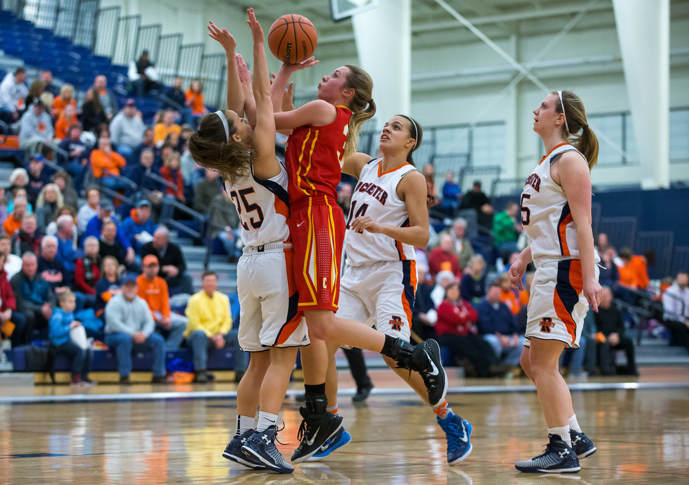 Charleston's Morgan Sherwood (33) puts up a basket against Rochester's Sydney Lett (25) in the first half during the Class 3A Rochester Sectional at the Rochester Athletic Complex , Monday, Feb. 23, 2015, in Rochester, Ill. Justin L. Fowler/The State Journal-Register