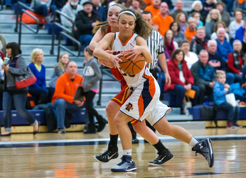 Rochester's Sydney Lett (25) pulls in an inbounds pass against Charleston's Paige Swango (24) in the first half during the Class 3A Rochester Sectional at the Rochester Athletic Complex , Monday, Feb. 23, 2015, in Rochester, Ill. Justin L. Fowler/The State Journal-Register