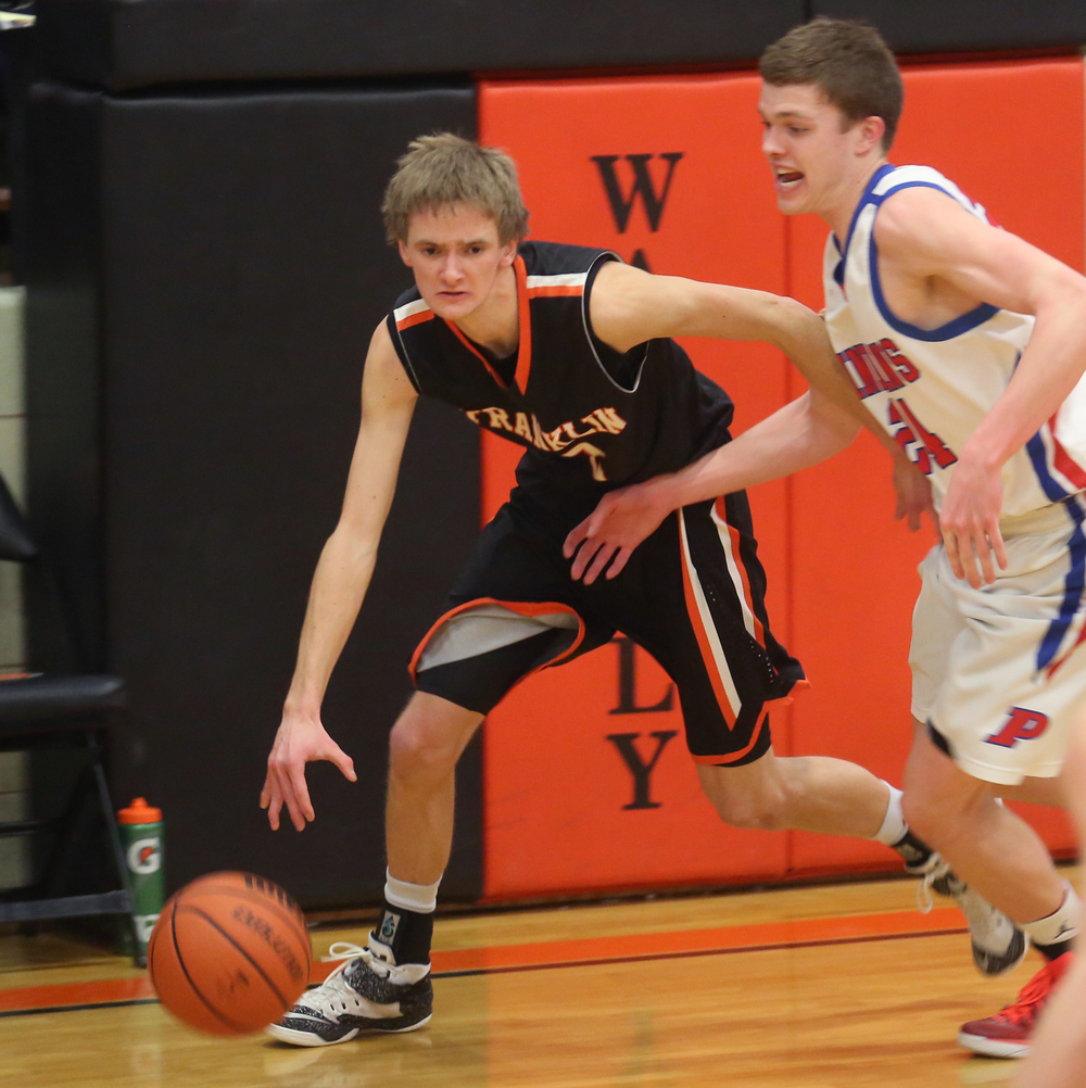 Franklin player Paul Morris drives around Pawnee's Cade Puzey. Franklin defeated Pawnee 61-39 during a semifinal game at the 1A Waverly Regional Boys Basketball Tournament held at Waverly Grade School gymnasium on Wednesday evening, Feb. 25, 2015. David Spencer/The State Journal-Register
