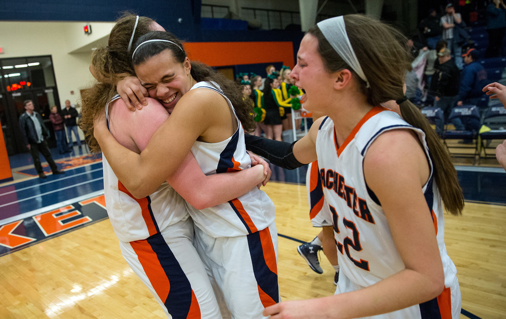 Rochester's Lyric Boone (14) hugs Angela Perry (54) as the Rockets celebrate their 40-39 victory over Normal U-High in the Girls Class 3A Rochester Sectional title game at the Rochester Athletic Complex, Thursday, Feb. 26, 2015, in Rochester, Ill. Justin L. Fowler/The State Journal-Register