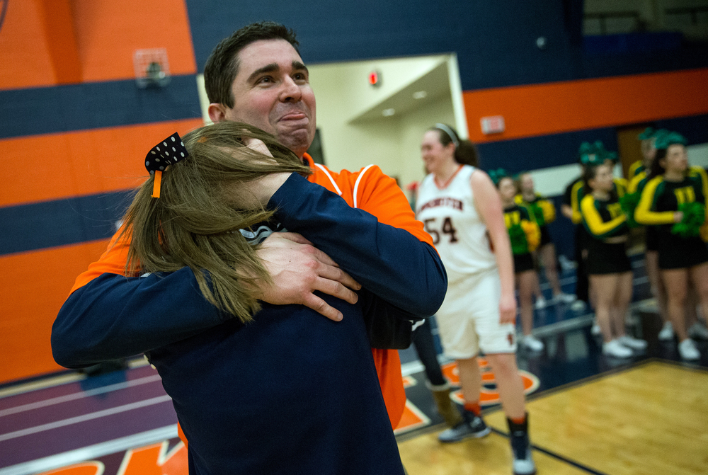 Rochester girls basketball head coach J.R. Boudouris celebrates after the Rockets defeated Normal U-High 40-39 in the Girls Class 3A Rochester Sectional title game at the Rochester Athletic Complex, Thursday, Feb. 26, 2015, in Rochester, Ill. Justin L. Fowler/The State Journal-Register
