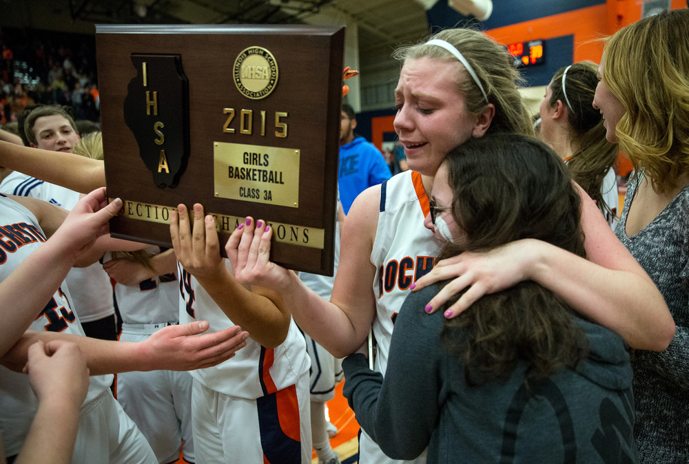 Rochester's Lucy Nuding (35) celebrates with the title after the Rockets defeated Normal U-High 40-39 in the Girls Class 3A Rochester Sectional title game at the Rochester Athletic Complex, Thursday, Feb. 26, 2015, in Rochester, Ill. Justin L. Fowler/The State Journal-Register