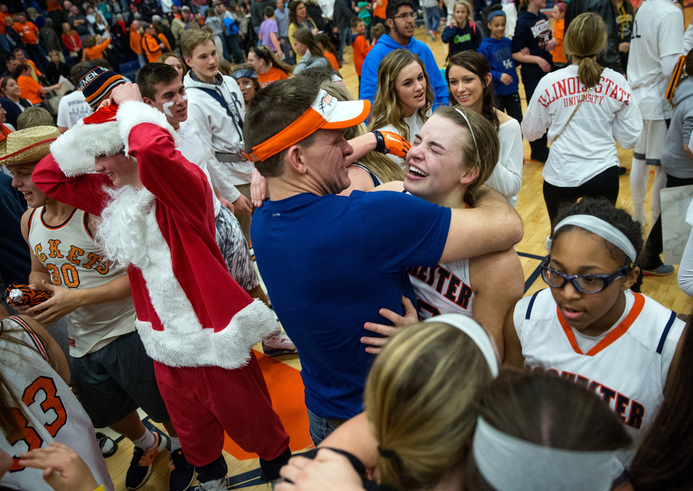 Rochester's Meagan McNicholas (33) gets a hug from her father, Mike McNicholas, after the Rockets defeated Normal U-High 40-39 in the Girls Class 3A Rochester Sectional title game at the Rochester Athletic Complex, Thursday, Feb. 26, 2015, in Rochester, Ill. Justin L. Fowler/The State Journal-Register