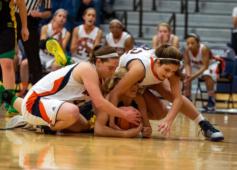 Rochester's Laryn Sapetti (32) and Sami Kearney (43) scramble for a loose ball against Normal U-High's Kate Olson (20) in the first half during the Girls Class 3A Rochester Sectional title game at the Rochester Athletic Complex, Thursday, Feb. 26, 2015, in Rochester, Ill. Justin L. Fowler/The State Journal-Register