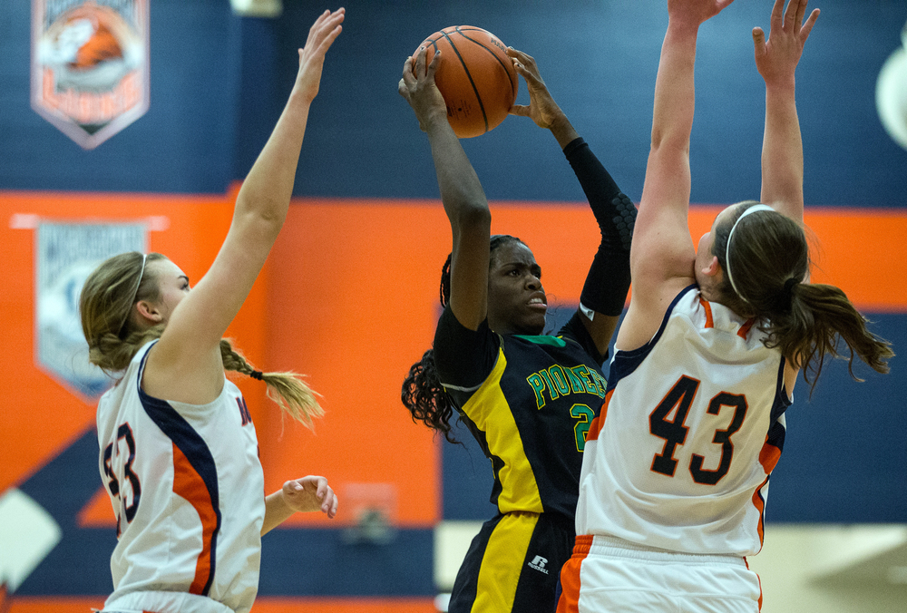 Normal U-High's Chante Stonewall (22) is swarmed by Rochester's Sami Kearney (43) and Meagan McNicholas (33) as she passes the ball to a teammate in the first half during the Girls Class 3A Rochester Sectional title game at the Rochester Athletic Complex, Thursday, Feb. 26, 2015, in Rochester, Ill. Justin L. Fowler/The State Journal-Register