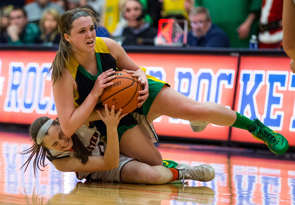 Rochester's Aubrey Magro (20) and Normal U-High's Avery Hamm (24) battle for a loose ball in the first half during the Girls Class 3A Rochester Sectional title game at the Rochester Athletic Complex, Thursday, Feb. 26, 2015, in Rochester, Ill. Justin L. Fowler/The State Journal-Register
