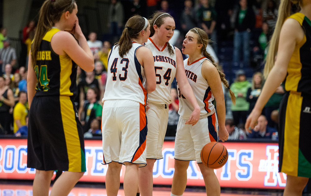 Rochester's Meagan McNicholas (33) cheers on Rochester's Angela Perry (54) after she hit two free throws to put the Rockets up 40-39 over Normal U-High in the second half during the Girls Class 3A Rochester Sectional title game at the Rochester Athletic Complex, Thursday, Feb. 26, 2015, in Rochester, Ill. Justin L. Fowler/The State Journal-Register