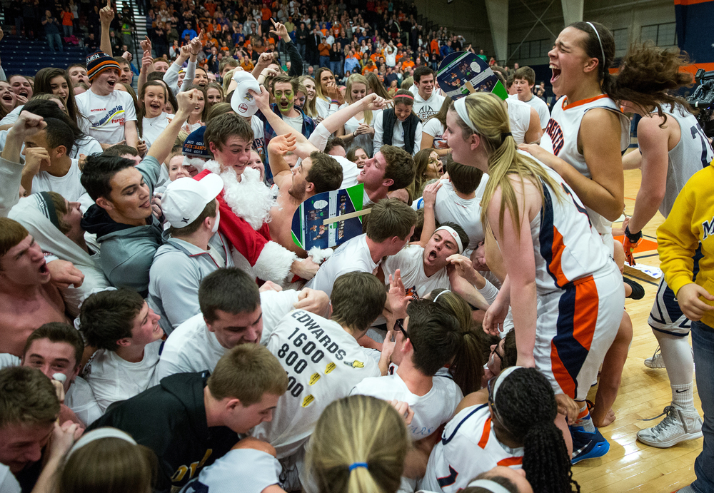 The Rochester Rockets are swarmed by the student section after they defeated Normal U-High 40-39 in the second half during the Girls Class 3A Rochester Sectional title game at the Rochester Athletic Complex, Thursday, Feb. 26, 2015, in Rochester, Ill. Justin L. Fowler/The State Journal-Register