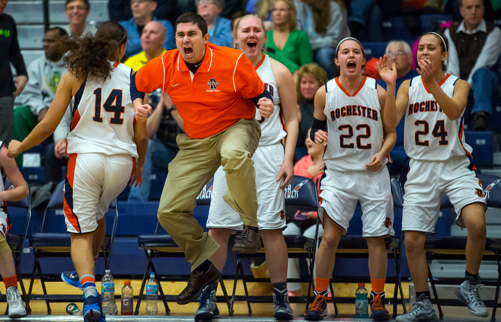 Rochester girls basketball head coach J.R. Boudouris leaps into the air as the Rockets close the gap to two 36-34 against Normal U-High in the second half during the Girls Class 3A Rochester Sectional title game at the Rochester Athletic Complex, Thursday, Feb. 26, 2015, in Rochester, Ill. Justin L. Fowler/The State Journal-Register