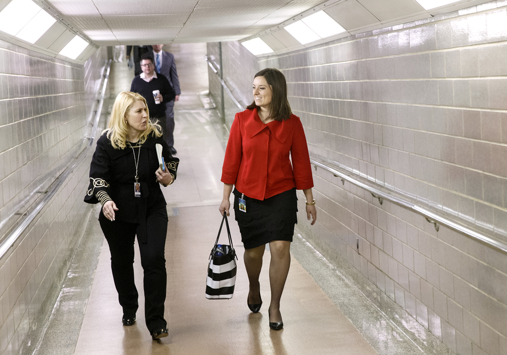 Vicki Crawford, left, press spokesperson at the Office of Illinois House Republican Leader, accompanies Avery Bourne, the new representative from the 95 District, as she makes her way from her Stratton Building office to the House of Representatives Friday, Feb. 20, 2015. Bourne was selected to replace Wayne Rosenthal in the 95th District after Gov. Bruce Rauner appointed Rosenthal to head the Illinois Department of Natural Resources. Ted Schurter/The State Journal-Register