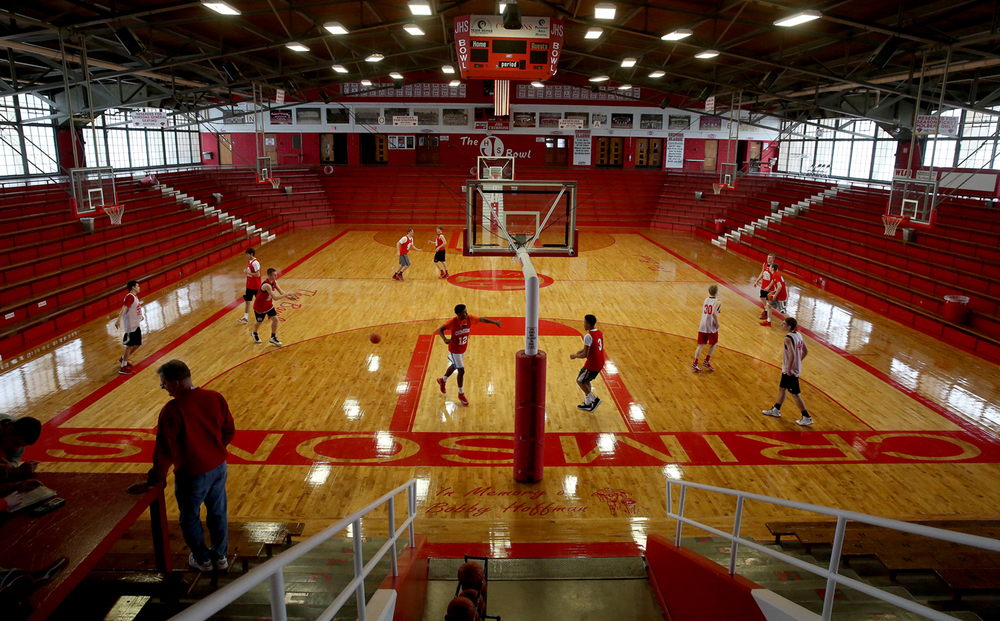 Built in 1952 by the Jacksonville School District, the JHS Bowl seen here with the JHS basketball team on the floor during practice on Wednesday, Feb. 25, 2015, is part of a 2-acre city block that is now part of the historic district. It was built by Hugh Gibson, and is one of around 30 semi-subterranean gymnasiums in the Midwest by a patented design by architect Ralph Legeman. The Jacksonville Historic District's designation on the National Register of Historic Places recently included a boundary extension adding an additional 43 acres and 68 structures for a total of 368 acres and 771 principal buildings, representing 39 architectural styles, subtypes and vernacular building forms. The boundary extension is made up of four separate areas known as Fairview, Finley, Mound, and JHS Bowl.  David Spencer/The State Journal-Register